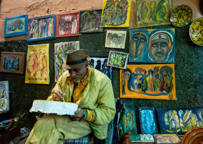 Portrait of a Moroccan painter in the small colourful streets of Marrakech, Morocco. taken by Ellis work photography