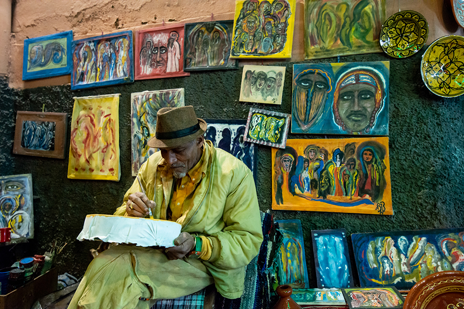 Painter in the streets of Marrakech, Morocco
