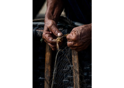 Hands of a fisherman in Da Nang, Vietnam