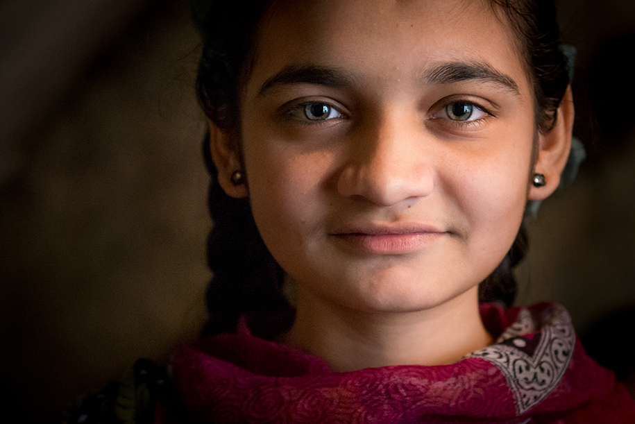 Portrait of a girl from India. Nice soft lighting. She has big beautiful eyes. Ellis kids photography