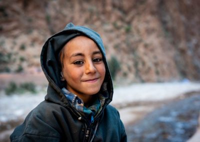 Portrait of a boy from Morocco, from the ancient Berber tribe. Mountain on the background. Kids photography by Ellis Peeters