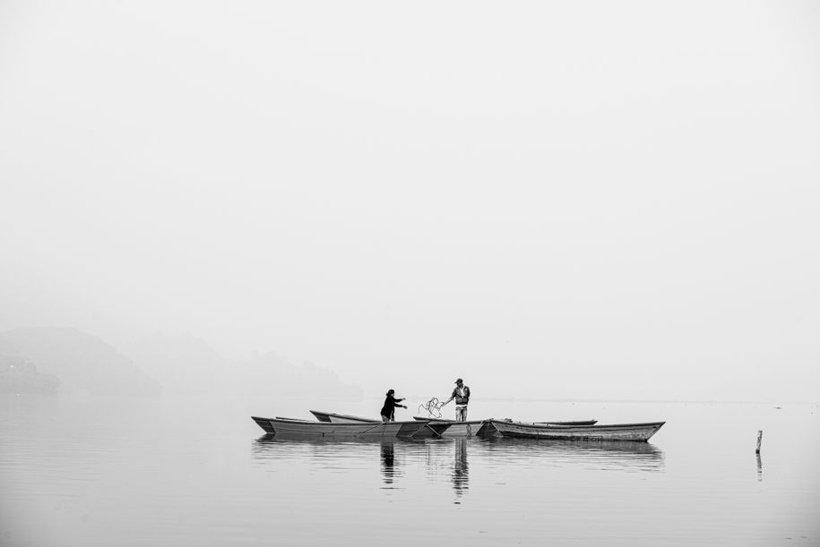 Couple fishing in the lake of Pokhara, Nepal