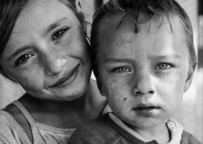 Brother and sister portrait. Black and white photo by Ellis photography. Close up of a boy and a girl with big eyes.