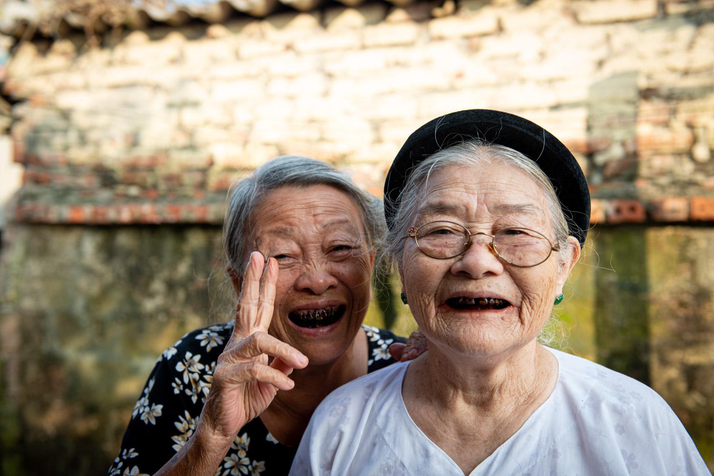 Portrait of old ladies posing peace in Vietnam