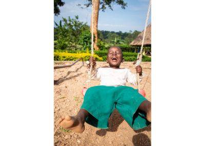 Orphan boy on a swing in Uganda