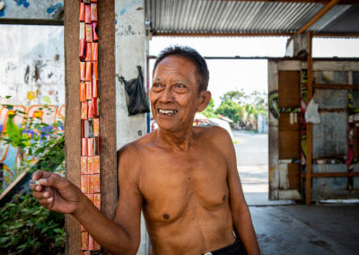 Portrait of an old Indonesian man smoking a sigaret