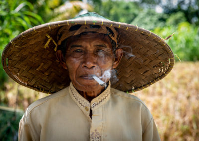 Portrait of an Indonesian worker smoking a sigaret