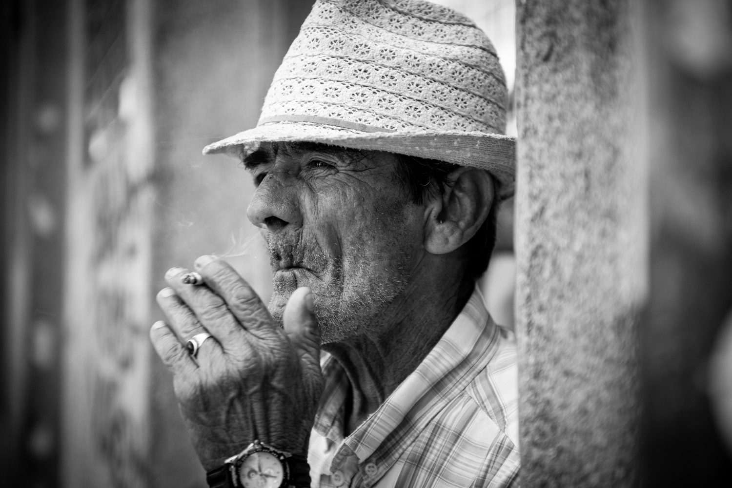 Portrait of an old man smoking a sigaret in Portugal