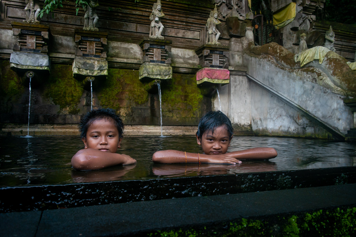 Portrait of kids in a water temple in Bali, Indonesia.